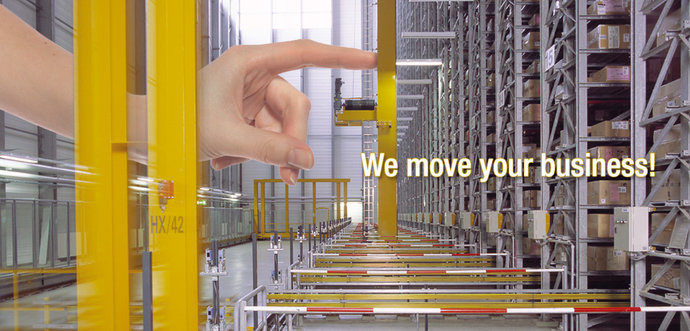A finger is pushing a automated storage / retrieval system (AS/RS)